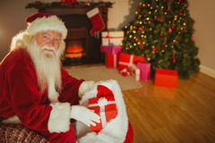 Cheerful santa claus stocking gifts Royalty Free Stock Photography