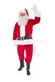Cheerful santa claus waving Royalty Free Stock Image
