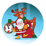 Cheerful Santa with the deer give gifts. Stock Photography