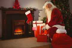 Cheerful santa delivering gifts at christmas eve Stock Photos