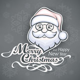 Cheerful Santa face on grey Royalty Free Stock Photography