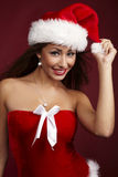 Cheerful santa helper girl Stock Image