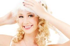 Cheerful santa helper girl royalty free stock photos