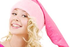 Cheerful santa helper girl. Picture of cheerful santa helper girl over white royalty free stock photography