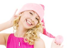 Cheerful santa helper girl. Picture of cheerful santa helper girl over white royalty free stock photo