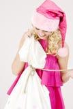 Cheerful santa helper girl with big bag Royalty Free Stock Photos