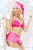 Cheerful santa helper girl with big bag Royalty Free Stock Image