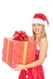 Cheerful santa helper girl with big gift box Stock Images