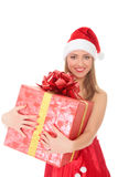 Cheerful santa helper girl with big gift box Stock Images