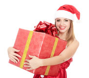 Cheerful santa helper girl with big gift box Stock Photo