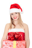 Cheerful santa helper girl with gift box Stock Photo