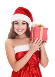 Cheerful santa helper girl with a gift box. Royalty Free Stock Photography