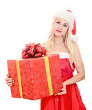 Cheerful santa helper girl with gift box royalty free stock photography