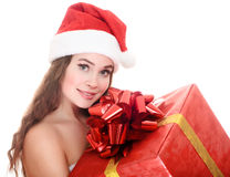 Cheerful santa helper girl with a gift box. Stock Photos