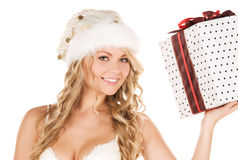 Cheerful santa helper girl with gift box Royalty Free Stock Images
