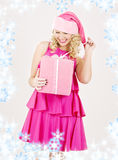 Cheerful santa helper girl with gift box Royalty Free Stock Image