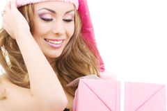 Cheerful santa helper girl with gift box Stock Photos