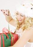 Cheerful santa helper girl with gift box Royalty Free Stock Image