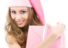 Cheerful santa helper girl with gift box Stock Photo