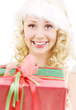 Cheerful santa helper girl with gift box Stock Photography