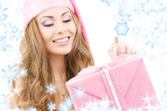 Cheerful santa helper girl with gift box Stock Image