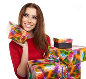 Cheerful santa helper girl with gift box Royalty Free Stock Photos