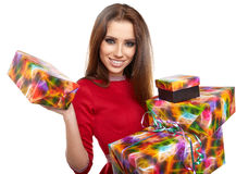 Cheerful santa helper girl with gift box Stock Images