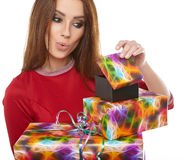 Cheerful santa helper girl with gift box Royalty Free Stock Photo