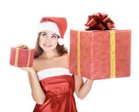 Cheerful santa helper girl with gift boxes. Stock Images