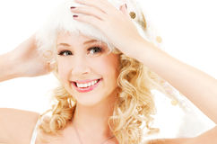 Cheerful santa helper girl. Picture of cheerful santa helper girl over white stock photos