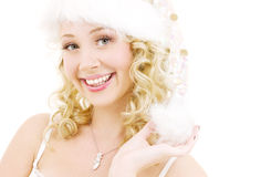 Cheerful santa helper girl. Picture of cheerful santa helper girl over white royalty free stock photos