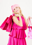Cheerful santa helper girl with shopping bags Stock Images