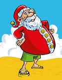 Cheerful Santa at the seaside. Fun Christmas greeting card of a cheerful Santa with a protruding belly at the seaside standing on a sandy beach in shorts and Stock Photography