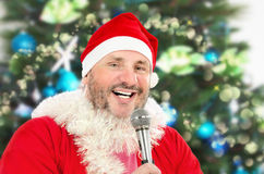 Cheerful Santa singing with microphone Royalty Free Stock Photos