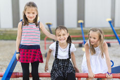 Cheerful school age child play on playground school Royalty Free Stock Images