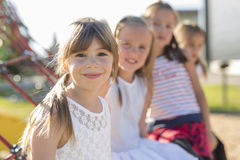 Cheerful school age child play on playground school Royalty Free Stock Photos