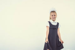 Cheerful school girl standing Royalty Free Stock Photos