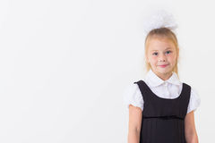 Cheerful school girl standing, isolated Royalty Free Stock Images