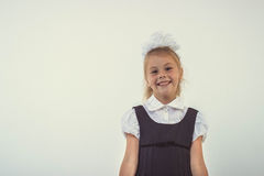 Cheerful school girl standing and smiling Royalty Free Stock Photos