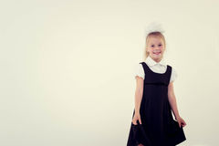 Cheerful school girl standing and smiling Stock Photography