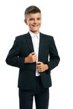 Cheerful schoolboy corrects jacket Stock Photo