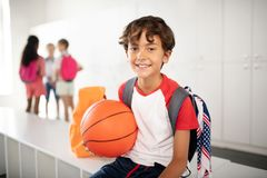 Cheerful schoolboy feeling excited before PE class