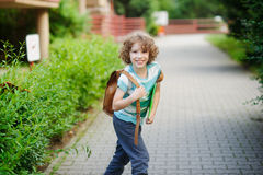 Cheerful schoolboy goes to school. Stock Image