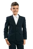 Cheerful schoolboy standing on a white background Royalty Free Stock Photos