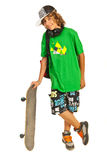 Cheerful schoolboy teen with skateboard. Cheerful schoolboy teen boy with skateboard isolated on white background Stock Photo