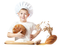 Cheerful scullion boy with a loaf of rye bread Stock Images