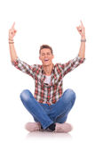 Cheerful seated young man Stock Photography