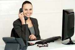 Cheerful secretary advising her client Stock Photography