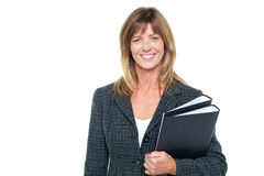Cheerful secretary holding business files Royalty Free Stock Photo