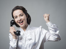 Cheerful secretary on the phone Stock Image
